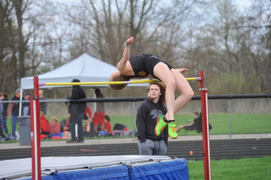 Drew Krassow holds the school's indoor high jump record of 5-05.