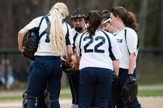Burlington huddles together on the mound during the girls softball game between the South Burlington Wolves and the Burlington Sea Horses at Leddy Park on Tuesday afternoon April 23, 2019 in Burlington, Vermont.