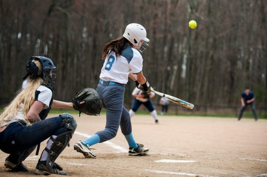 South Burlington's Sofia Richland (8) hits the ball during the girls softball game between the South Burlington Wolves and the Burlington Seahorses at Leddy Park on Tuesday afternoon April 23, 2019 in Burlington, Vermont.