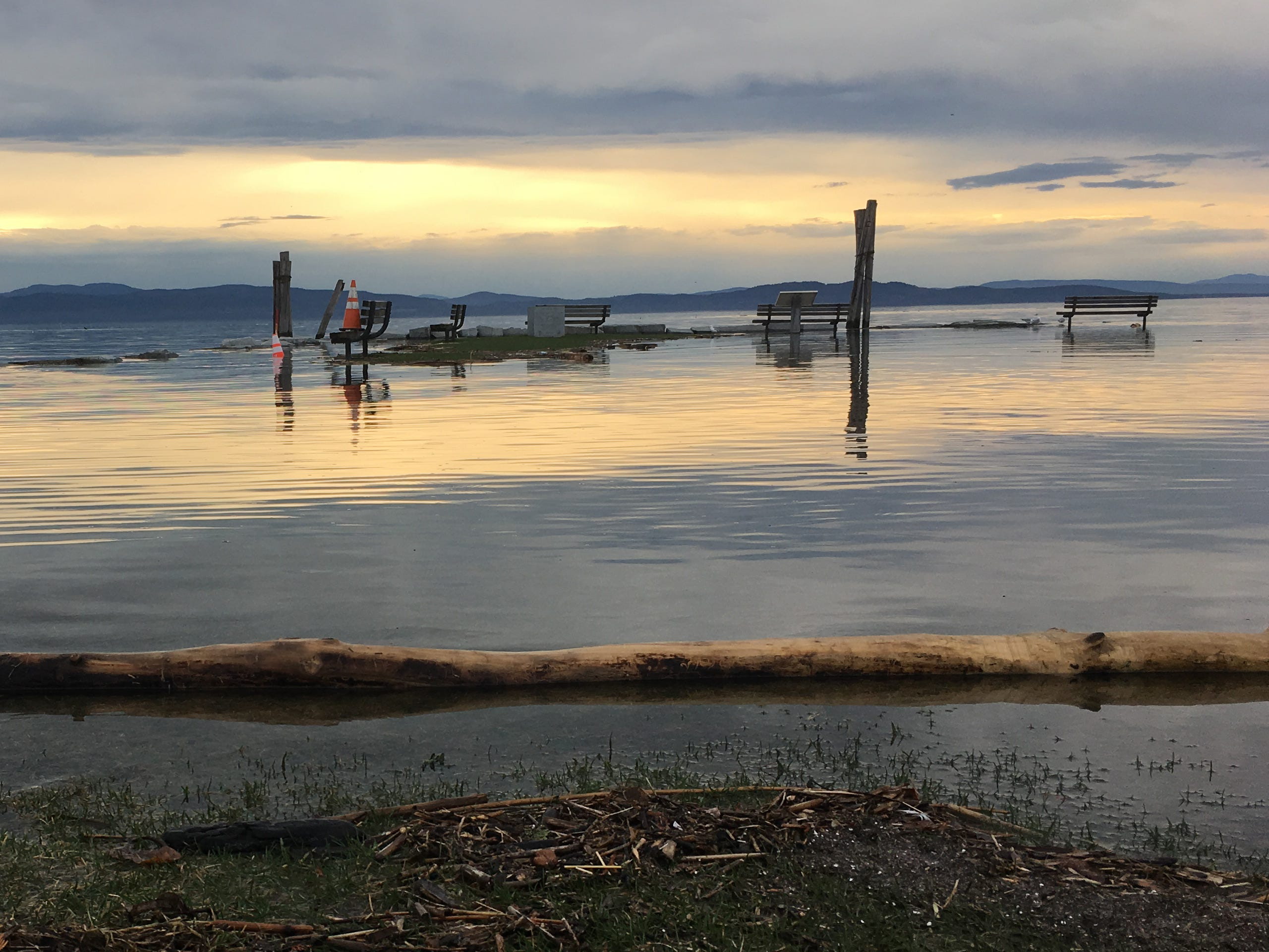 Benches on Perkins Pier in Burlington remain off-bounds to anyone who values dry feet on Tuesday, April 23, 2019.