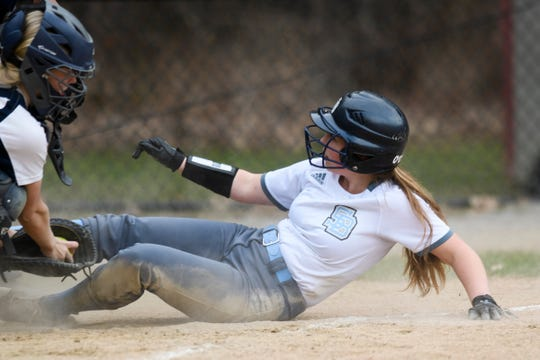 South Burlington's She O'Connor (18) is tagged out as she slides into home plate during the girls softball game between the South Burlington Wolves and the Burlington Sea Horses at Leddy Park on Tuesday afternoon April 23, 2019 in Burlington, Vermont.