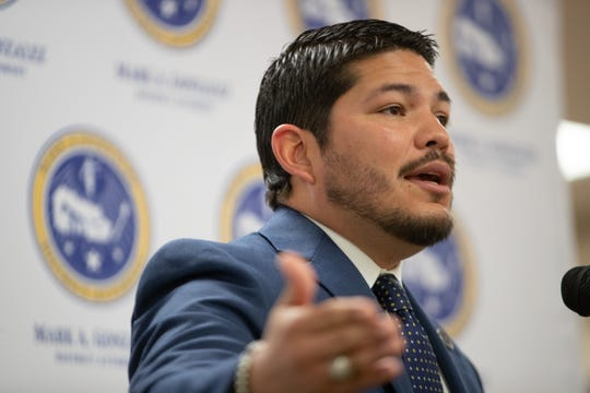 Nueces County District Attorney Mark Gonzalez walks thought the presses of the new cite and release program during a press conference at the Nueces County Courthouse on Wednesday, April 24, 2019.