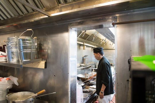 Chef and owner Steve Lin works inside the kitchen at Oceancrat The Boiling Seafood in Mount Laurel, N.J.