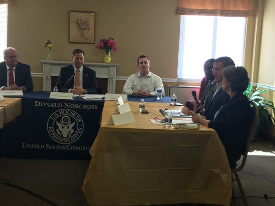 Second from left, Congressman Donald Norcross (D-Camden) listens to complaints about the high cost of prescription drugs during a visit to Pennsauken Towers in Pennsauken Wednesday.
