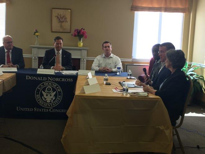 Second from left, Congressman Donald Norcross (D-Camden) listens to complaints about the high cost of prescription drugs during a visit to Pennsauken Towers in Pennsauken Wednesday.