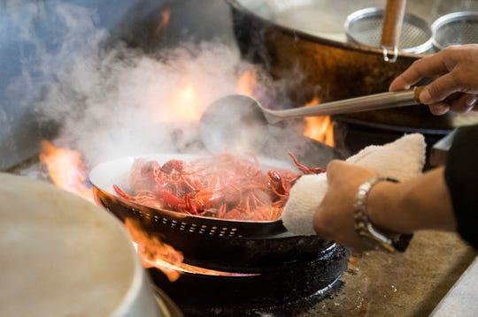 Chef and owner Steve Lin prepares crawfish at Oceancrat The Boiling Seafood in Mount Laurel, N.J.