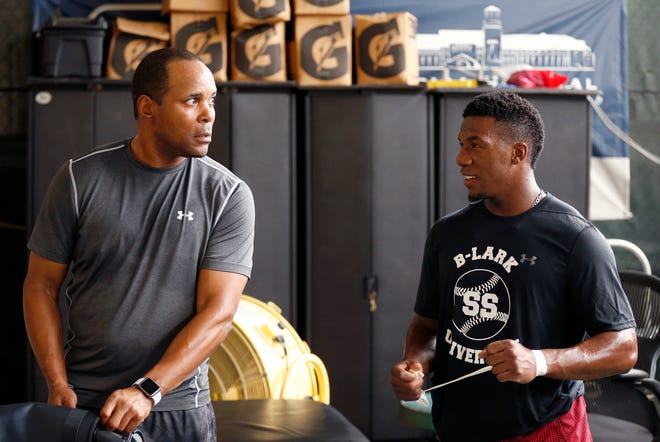 Former Reds shortstop Barry Larkin packs up with former Reds prospect Shed Long after a boxing workout at the ESPN Wide World of Sports Complex in Orlando, Fla., on Friday, Dec. 8, 2017.