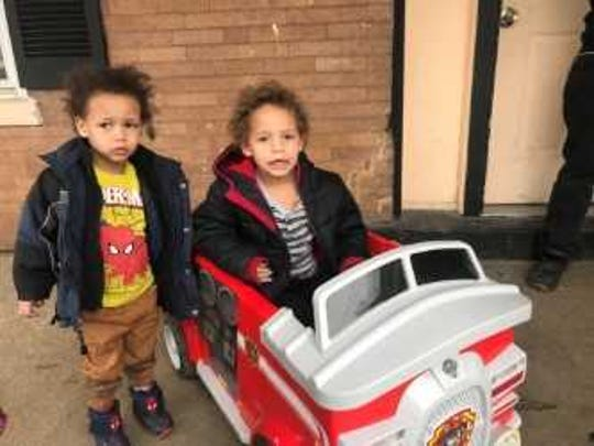 Kaliq and K'juan Reynolds with K'juan's new fire truck. After the Dec. 10th fire, K'juan asked for a fire truck for Christmas.