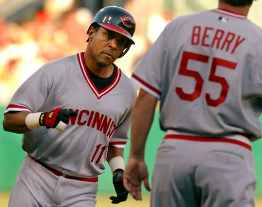 Cincinnati Reds' Barry Larkin (11) trots around third to greetings from coach Mark Berry (55) after Larkin's solo home run in the first inning off Pittsburgh Pirates' Josh Fogg, Saturday, July 24, 2004, in Pittsburgh. (AP Photo/Gene J. Puskar)