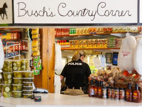 Investigators seize property at Busch's Country Corner inside Findlay Market in Over-the-Rhine on May 10, 2018.