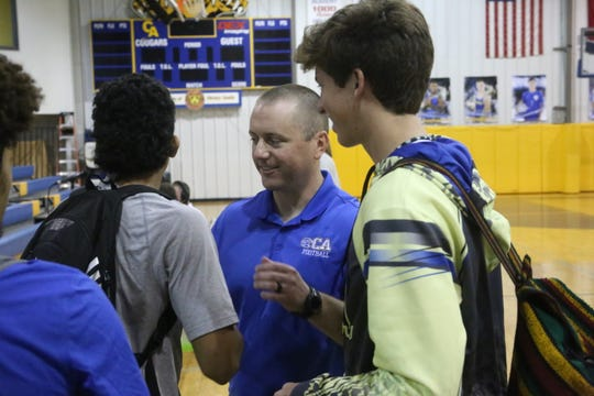 New Clarksville Academy head football coach John Crosby greets students after his press conference Wednesday, April 24, 2019.
