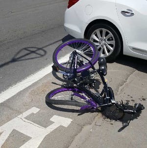A bicycle rider was hit by a car on Riverside Drive Wednesday, April 24, 2019.
