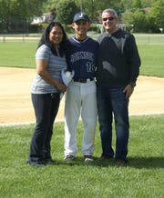 Michael Sot Jr., flanked by his parents, Candice and Michael Sr., during the Arthur L. Johnson Regional High School baseball program's 2017 Senior Day