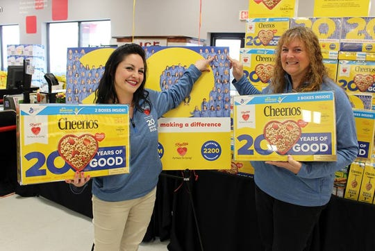 ShopRite of Clinton associates Brittany Wulff (left) and Theresa Linser (right) pose with their Cheerios boxes during a special Cheerios box unveiling event on Thursday, April 11. The two associates joined hundreds of other ShopRite associates in raising $1.5 million to fight hunger as part of the annual ShopRite Partners in Caring Cheerios contest. The money raised supports regional food banks and pantries in communities served by ShopRite stores.