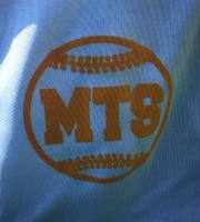 Clark Little Leaguers are wearing Michael Thomas Sot's initials on the sleeve of their jerseys this season