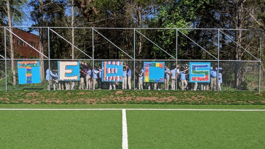 In celebration of Earth Day, the SmartTech classes at Thomas Edison EnergySmart Charter School created a TEECS logo sign made out of recycled bottle caps. Each class had a part in sorting caps by color and glueing them onto the boards. The school hung them on the fence of the soccer field.