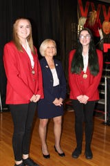 Custom Automotive Painting gold medalists Brianna Roper (left) and Alexus Rothschild of Bridgewater (right) pose for a photo with Somerset County Freeholder Deputy Director Pat Walsh (center) after receiving their medals at the 2019 New Jersey SkillsUSA Championships Awards Ceremony.