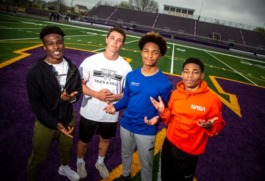 Waukee High School runners Sam Yeaway, Zach Eaton, Aaron Smith, Kahlil Hicks-Jumper stand for a portrait after practice Monday, April 22, 2019.