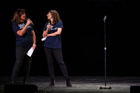 The Des Moines Register's Lee Rood and Rekha Basu kick off the Des Moines Storytellers Project's My Great Adventure event on Tuesday, April 23, 2019, in Des Moines.