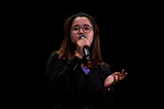 Grace Htee, born and raised at Mae La Refugee Camp in Thailand, talks about moving to the United States, during the Des Moines Storytellers Project's My Great Adventure event on Tuesday, April 23, 2019, at Hoyt Sherman Place in Des Moines.