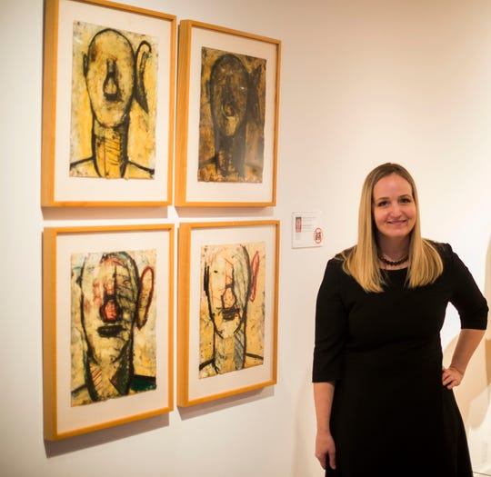 Laurie Ann Farrell, the Detroit Institute of Arts' former curator of contemporary art, stands in the contemporary galleries with four drawings by Detroiter Gordon Newton on Friday Oct. 28, 2016.