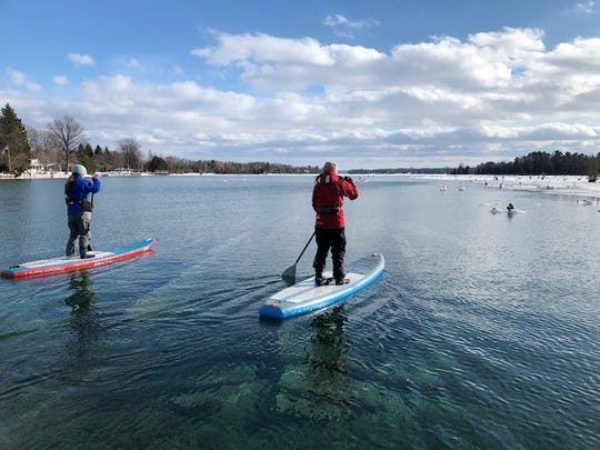 Sophia Christian and Paige Peters, both 13, plan to paddle board five miles across Straits of Mackinac Saturday, April 27, 2019, to raise awareness to Great Lakes preservation.