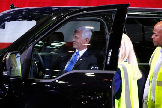 Vice President Mike Pence looks around inside the Ford F150 as Ford Motor Company Dearborn Truck Plant manager Debbie Manzano and Corey Williams, the assistant plant manager look on during Pence's visit and tour at the plant where the Ford F150 is produced in Dearborn, Michigan on Wednesday, April 24, 2019.