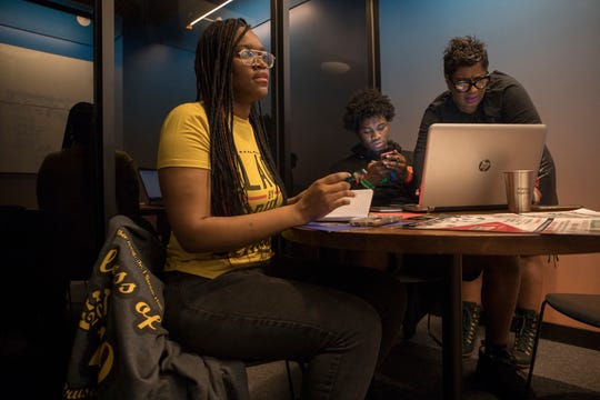 Keyanna Evans, right, 18, a senior at MLK High, and Terry Edwards, 17 a senior at Southeastern, crunch college tuition numbers with Jennifer Smith at WeWork, in Detroit.