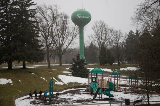 Kids play near the water tower at the Kindleberger Park in Parchment, Wednesday, Feb. 6, 2019.