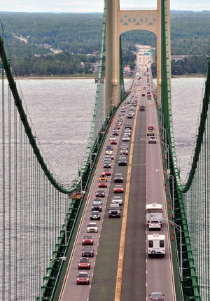 The MINI Coopers northbound on the bridge headed from the Lower Peninsula to the Upper Peninsula on Aug. 3, 2013.