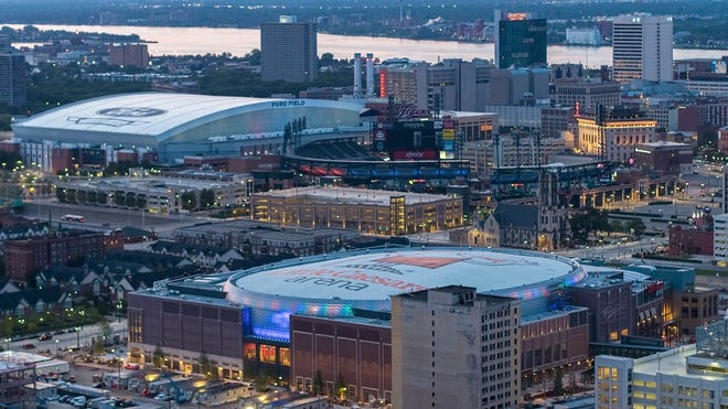 In an undated photo provided by Olympia Development of Michigan, Little Caesars Arena, foreground, is seen in Detroit with Ford Field and Comerica Park in the background.