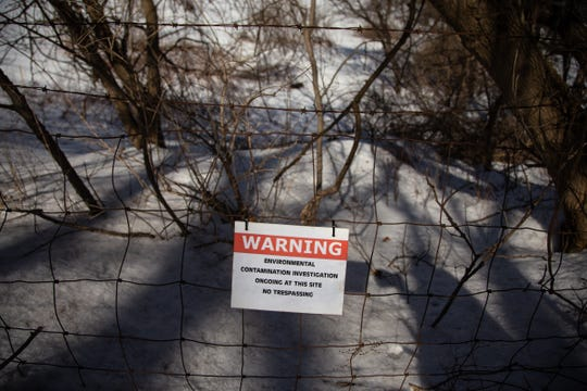 A sign posted on a fence around the former House Street landfill in Belmont warning of environmental contamination research is seen on Monday, March 11, 2019, where Wolverine Worldwide dumped their PFAS-containing waste for decades.