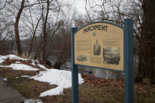 A Parchment history sign next to the Kalamazoo River in Parchment, Wednesday, Feb. 6, 2019.