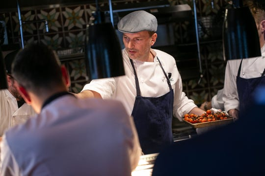 San Morello Chef & Owner Andrew Carmellini works on orders during the Detroit Free Press / Metro Detroit Chevy Dealers Top 10 Takeover at San Morello in downtown Detroit on Tuesday, April 23, 2019.