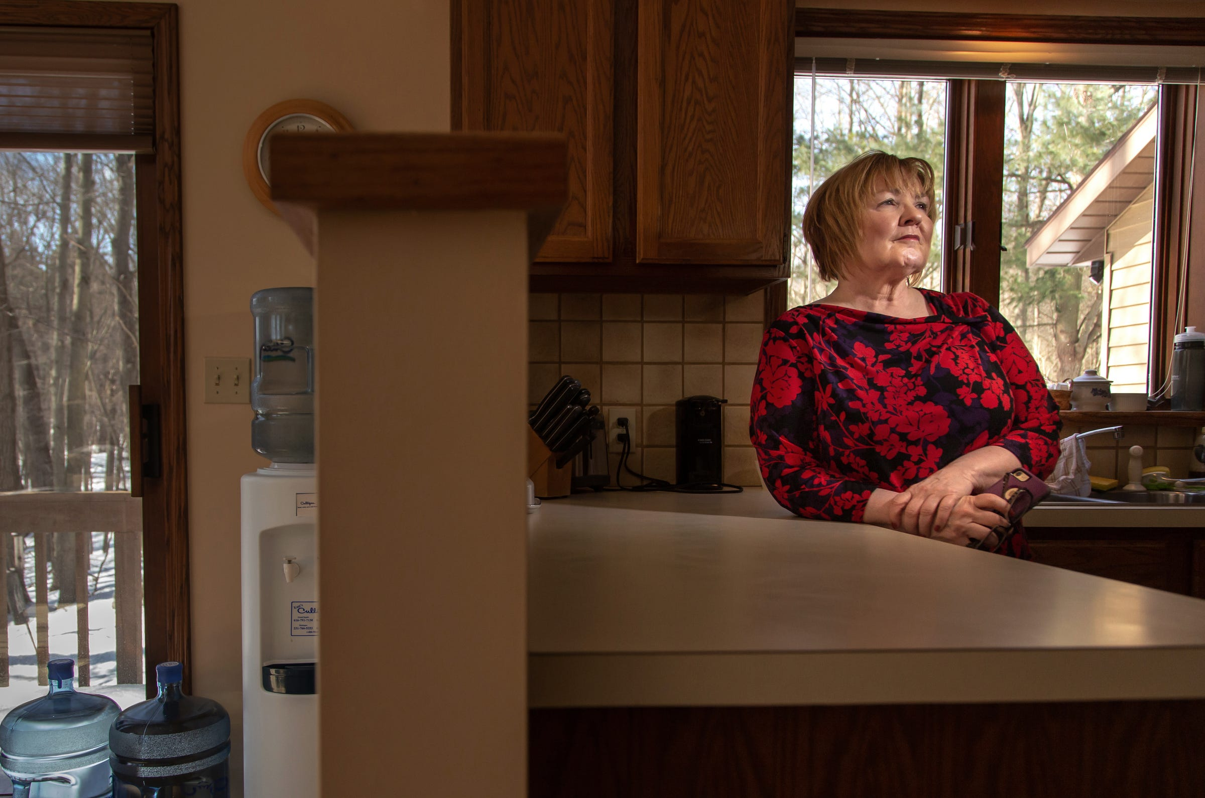 Sandy Wynn-Stelt of Belmont stands in her home on Monday, March 11, 2019. Wynn-Stelt lives across the street from the former House Street landfill, where Wolverine Worldwide dumped their PFAS-containing waste for decades. The DEQ informed her in 2017 that her well water had PFAS contamination as high as 78,000 parts per trillion. She has sky-high levels in her blood and her husband died of cancer over the past few years leaving her wondering if it's related.