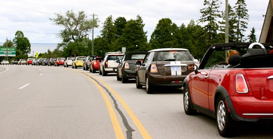 Minis on parade in St. Ignace after crossing the Mackinac Bridge into the UP. They didn't set a Guinness world record for number of Minis automobiles in a single parade, but the 848.5 Mini owners who showed up to drive across the Mackinac Bridge together Saturday, August 3, 2013 in an event dubbed Mini on the Mack had a good time making the attempt. Picture received August 3, 2013