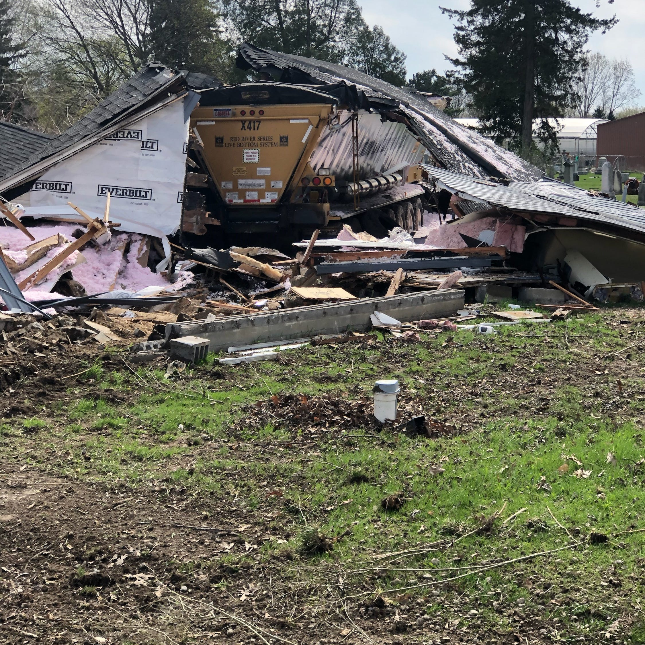Runaway truck destroys Macomb County house, cemetery headstones