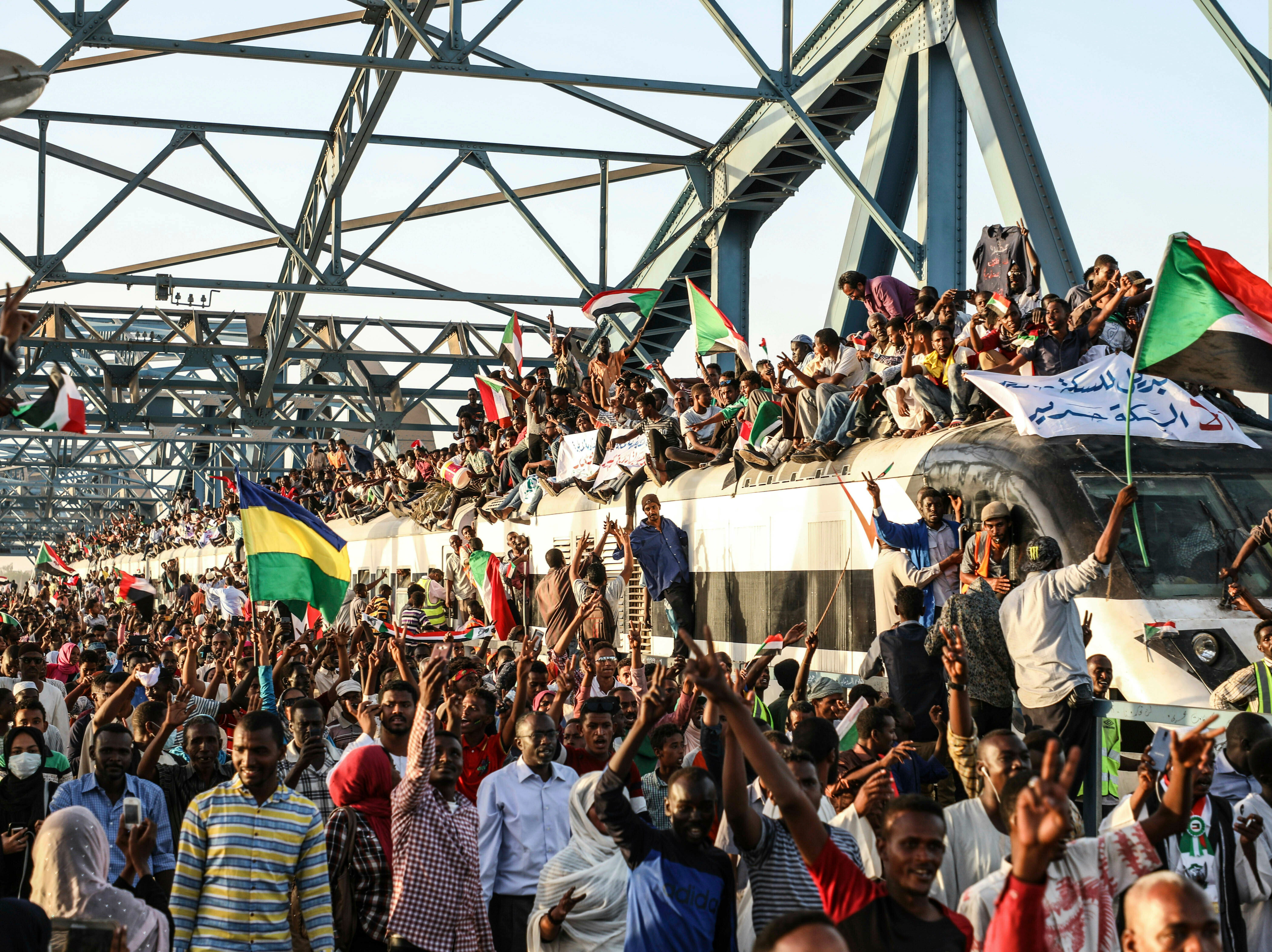 In this Tuesday, April 23, 2019, photo, Sudanese protesters crowd a train in the capital Khartoum.Activists were holding nationwide protests on Tuesday to press the military to hand over power to a civilian authority after the overthrow of President Omar al-Bashir earlier this month.