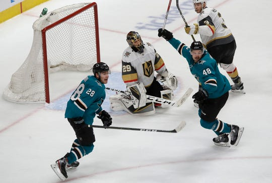 Golden Knights goaltender Marc-Andre Fleury, center, reacts between Sharks right wing Timo Meier (28) and center Tomas Hertl (48) after Logan Couture scored a goal during the third period of Game 7 on Tuesday.