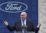 Ford Motor Co. CEO James Hackett talks outside the Michigan Central Depot in June.