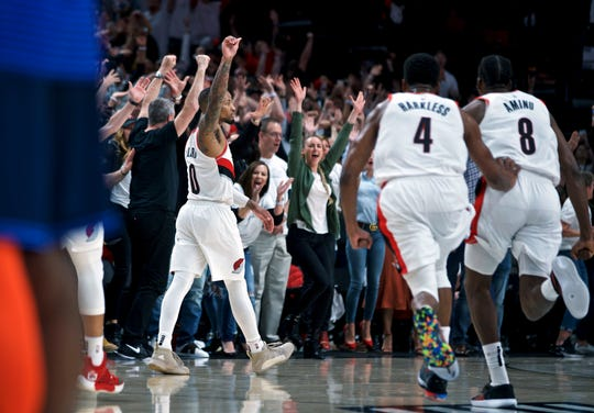 Trail Blazers guard Damian Lillard reacts after making the game-winning shot at the buzzer against the Thunder in Game 5 on Tuesday.