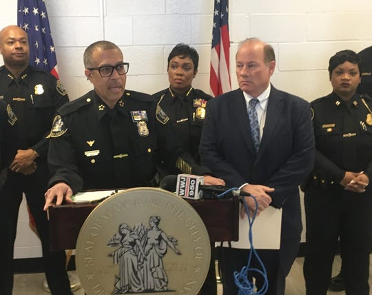 Detroit police chief James Craig and Mayor Mike Duggan address the media about racial issues at the city's 6th Precinct