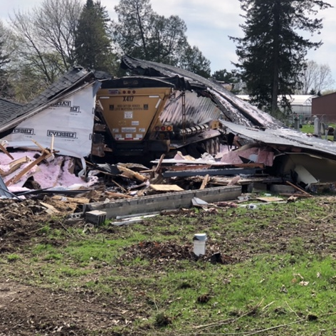 Semi demolishes Macomb Co. home; minor injuries reported