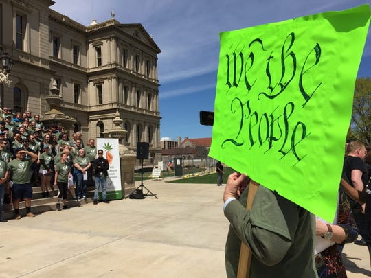 Protesters urging the state to more strictly enforce medical marijuana testing standards organized on the Capitol lawn Wednesday, April 24, 2019. Counter-protesters also attended the event, asking the state to delay implementation of those standards so as to prevent a shortage in the market.