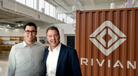 R.J. Scaringe, Rivian founder and CEO, and Ford Executive Chairman Bill Ford pose for a photo in Dearborn. Ford announced Wednesday that it is sinking a half-billion dollars into electric vehicle startup Rivianto work together on a new Ford electric vehicle based on Rivian underpinnings.