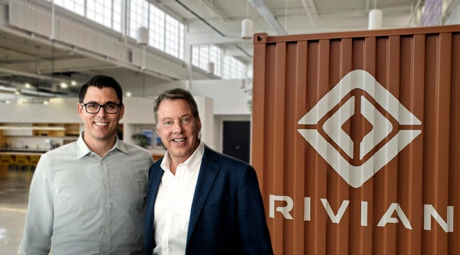 Rivian Automotive LLC CEO RJ Scaringe, left, and Ford Motor Co. Executive Chairman Bill Ford mark the Dearborn automaker's $500 million investment in the Plymouth-based electric-truck maker.