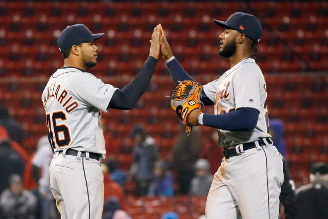 Detroit's Jeimer Candelario, left, and Niko Goodrum celebrate their win against the Red Sox in Tuesday's nightcap.