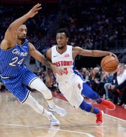 Point guard Ish Smith (14) played for nine teams in six seasons before spending the past three with the Pistons.