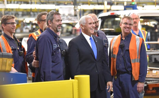 Vice President Mike Pence poses for a group shot with workers at Ford Motor Co.'s Dearborn Truck Plant.