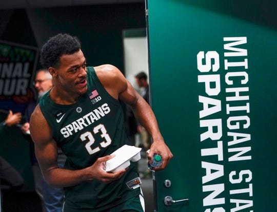 Michigan State's Xavier Tillman gets some lunch after a practice session for the semifinals of the 2019 Final Four at Minneapolis.